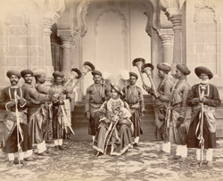 H.H. Shahu Chhatrapati Maharaj [seated with palace servants].